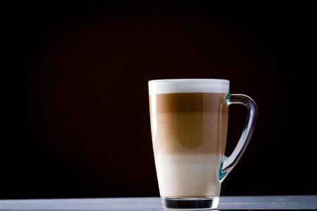 Original latte macchiato coffee in transparent glass.