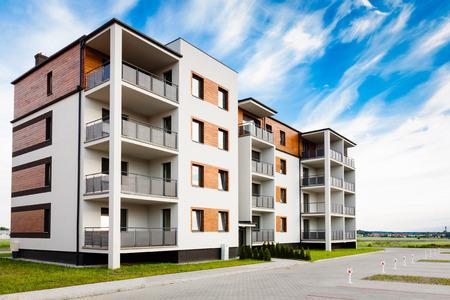 Foto de New multi-family block with balconies and bright facade decorated with wood paneling. - Imagen libre de derechos