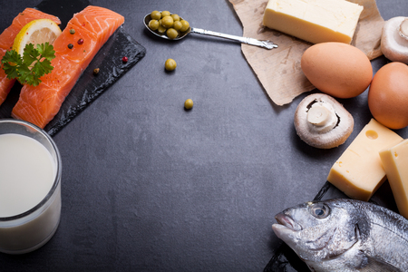 Photo pour Black table with ingredients of food rich in vitamin D and omega 3, with copy space. - image libre de droit