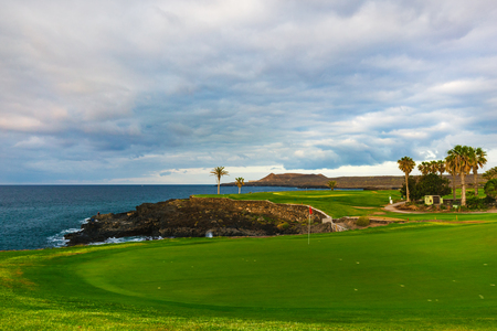 Golf course along rocky coastline. Tenerife, Spain.