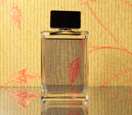 luxury fragrant perfume vial on the mirror surface
