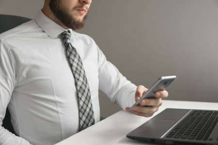 White background. Shopping online. sending email, mobile phone. Close up telephone. Office work concept. Businessman uses a smartphone.