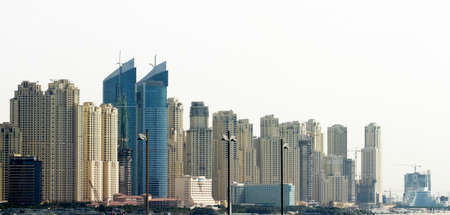 Photo pour Office buildings and skyscrapers in Dubai, United Arab Emirates. Dubai was the fastest developing city in the world. - image libre de droit