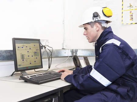 Photo pour Young engineer working with computer in office. Indoor - image libre de droit