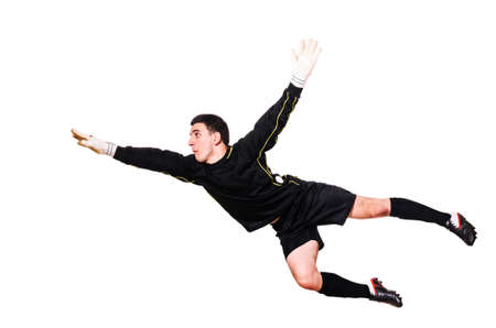 soccer goalkeeper is catching a ball, isolated on white background
