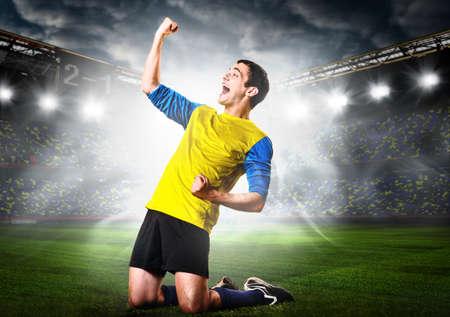 soccer or football player is celebrating goal on stadium