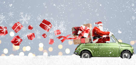 Foto de Santa Claus on car delivering Christmas or New Year gifts at snowy gray background - Imagen libre de derechos