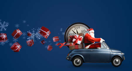 Photo pour Christmas countdown arriving. Santa Claus on car delivering New Year gifts and clock at blue background - image libre de droit