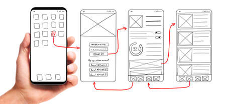 Photo for UI development. Male hand holding smartphone with wireframed user interface screen prototypes of a mobile application on white background. - Royalty Free Image