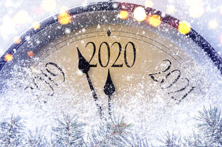 Photo pour Countdown to midnight. Retro style clock counting last moments before Christmass or New Year 2020. - image libre de droit