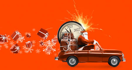 Photo pour Christmas is coming. Santa Claus on toy car delivering New Year 2021 gifts and countdown clock at orange background with fireworks - image libre de droit