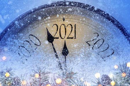 Foto de Countdown to midnight. Retro style clock counting last moments before Christmas or New Year 2021. - Imagen libre de derechos