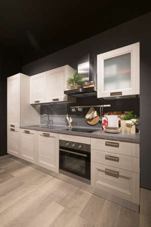 Photo pour Wide angle view of a modern kitchen interior, no people are visible. - image libre de droit