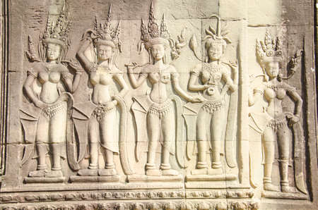 Relief of three dancers in the court of Angkor. Angkor Wat