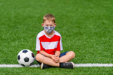 Foto de Football soccer training for kids. Boy running and kicking soccer ball. Young boy improving soccer skills - Imagen libre de derechos