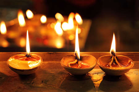 A mud lamp lit on the auspicious occasion of diwali