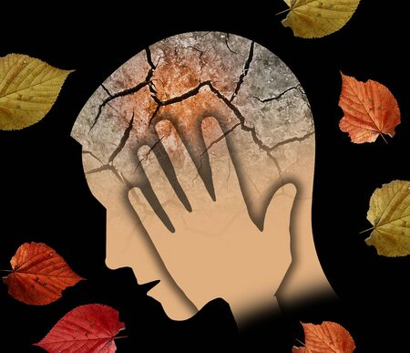 Foto de Autumn sadness and depression, young man. Stylized Male Head Silhouette Holding His Head.Photo-montage with Dry Cracked Earth and Autumn Leaves Symbolizing Depression. - Imagen libre de derechos