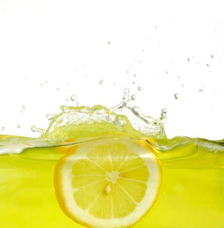 Image of lemon slice falling into juice