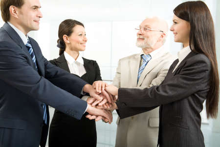 Foto de Business people joining their hands - Imagen libre de derechos