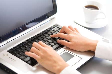 Photo pour Close-up of hand touching computer keys during work - image libre de droit
