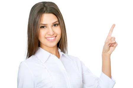Young beautiful business woman executive pointing at copyspace