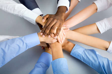 Foto de International  business team showing unity with their hands together - Imagen libre de derechos