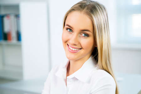 Foto per Closeup portrait of cute young business woman smiling - Immagine Royalty Free