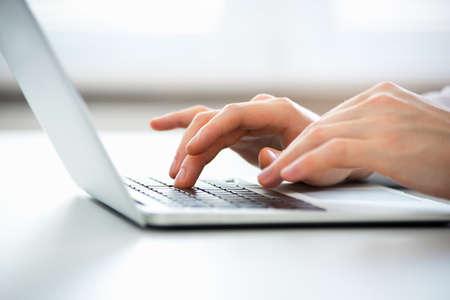 Photo pour Close-up of hands of business man typing on a laptop. - image libre de droit