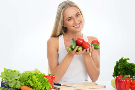 Photo for Young smiling pretty woman with vegetables - Royalty Free Image