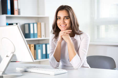 Photo for Young beautiful businesswoman with computer in an office - Royalty Free Image