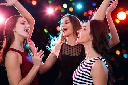 Photo pour Happy beautiful girls have fun at a Christmas party - image libre de droit