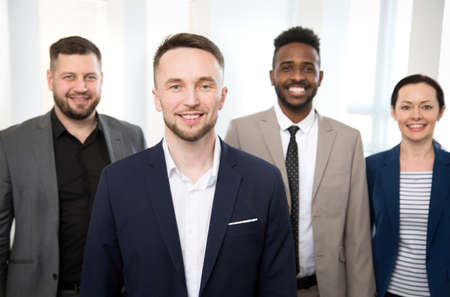 Photo for Portrait of successful businessman and his colleagues on the background at the office - Royalty Free Image
