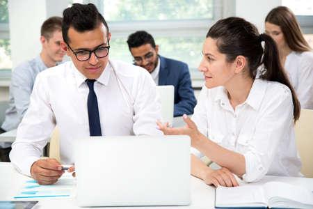 Photo pour Businesswoman explains to colleague a new project in the modern office - image libre de droit