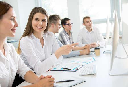 Foto de Businesswoman explains to colleague a new project in the modern office - Imagen libre de derechos