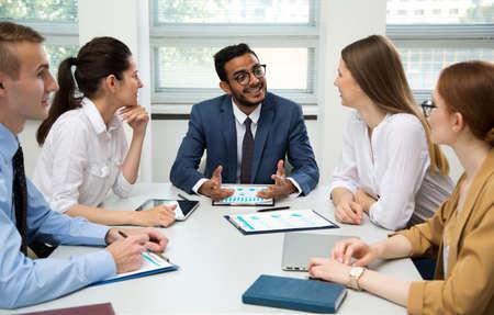 Photo pour International business team discuss a new project in the office - image libre de droit