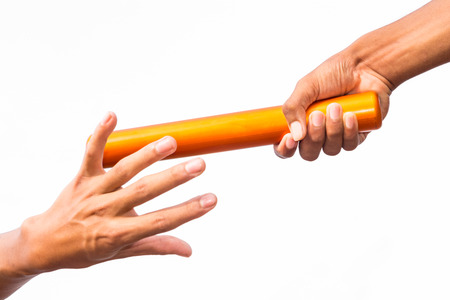 close-up of two male hands passing a relay baton against a white background