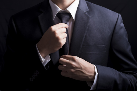 Businessman Adjust Necktie his Suit