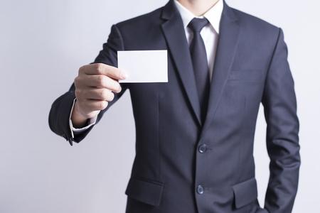 Photo pour Businessman Pick Business Card: Isolated White Background - image libre de droit