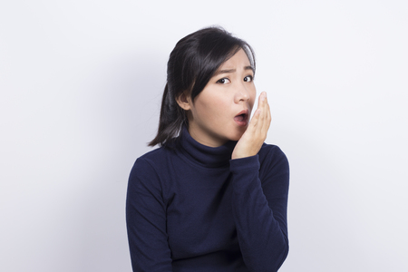Photo pour Health Care: Woman checking her breath with her hand - image libre de droit