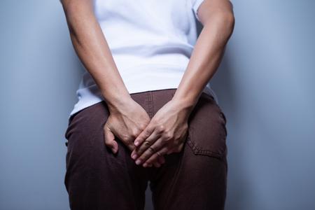Foto de Woman holding her bottom - Imagen libre de derechos