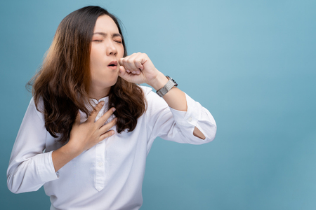 Woman has sore throat isolated over blue background