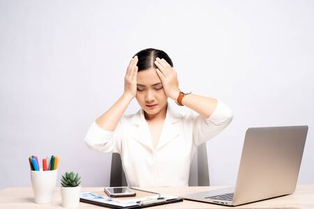 Photo pour Woman has headache at office isolated over white background - image libre de droit