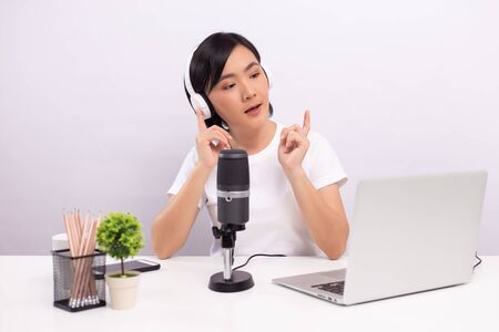 Photo for Woman blogger speaking in front of camera and recording video for social media - Royalty Free Image