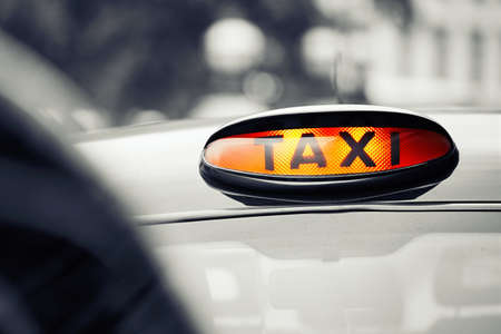 London black taxi cab sign on the street, UK