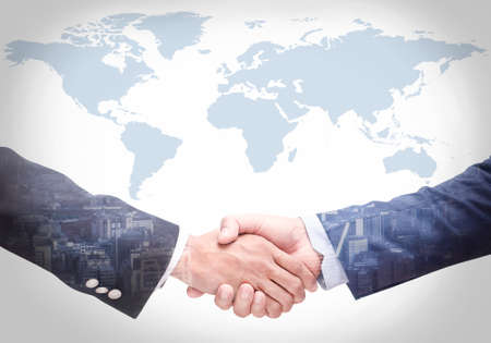 Photo pour Business people shake hands with a map in the background,Agreement, cooperation,Closeup - image libre de droit