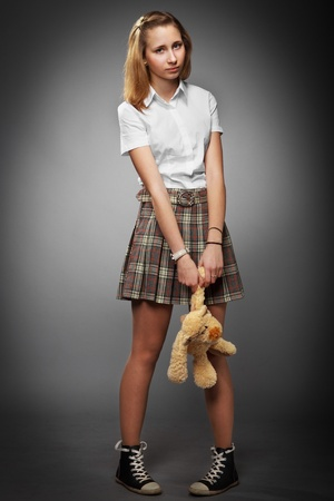 teenager school girl with teddy bear