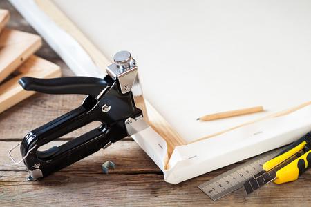Photo pour Artist canvas, canvas stretcher and staple gun on table - image libre de droit