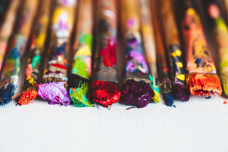 Photo pour Artist paintbrushes closeup on artistic canvas. Selective focus. - image libre de droit