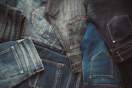 Fashion different jeans background. Retro toned.