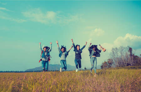 Photo pour Group of Young Asian women jumping enjoy travel trekking to destination in vacation time for go to camping. - image libre de droit